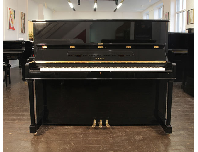 A 1989, Kawai CS-35N upright piano with a black case and polyester finish