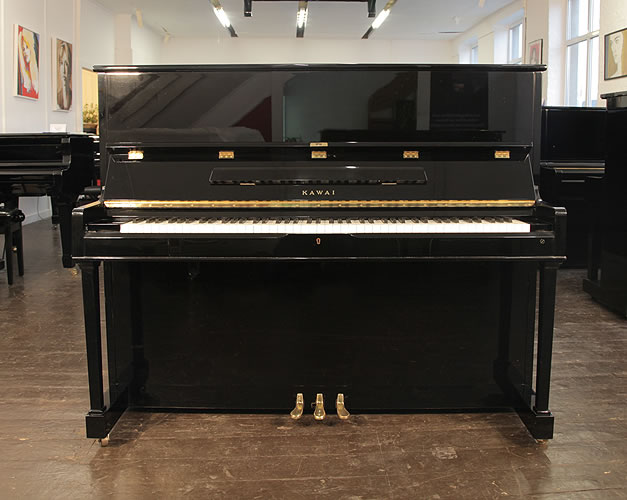 Kawai CS-35N upright piano for sale with a black case and a