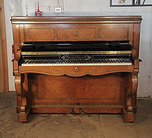 An 1854, Pleyel upright piano with a quartered, rosewood case. Cabinet features boxwood crossbanding inlay, double scroll legs and brass ormolu mounts