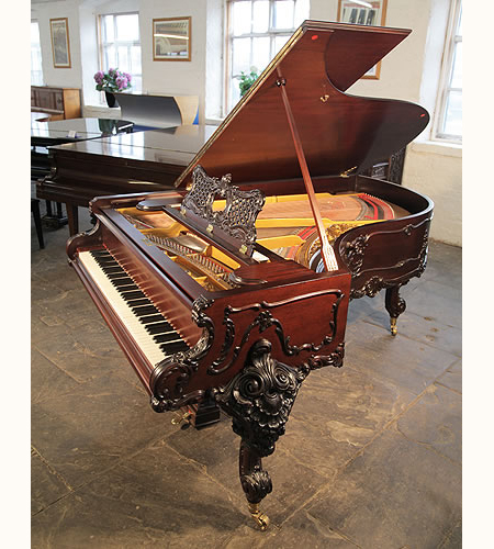A 1911, Rococo style, Schiedmayer Model 3 Grand Piano with an ornately carved, mahogany case and cabriole legs