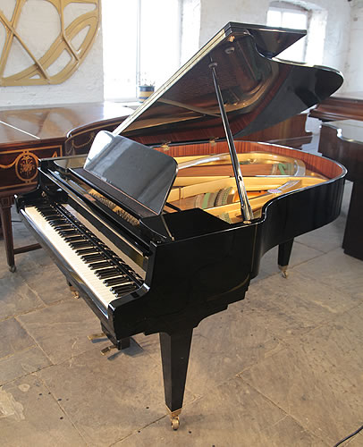 A 1965, Schimmel grand piano with a black case and tapered, square legs