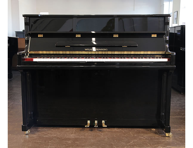 A Brand  New Steinberg Model AT-18 upright piano with a black case and brass fittings