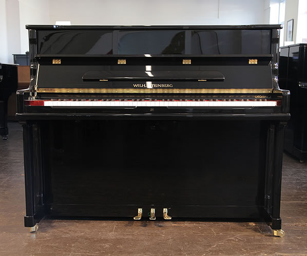 Piano for sale. New Steinberg Model AT-18 upright piano with a black case and brass fittings