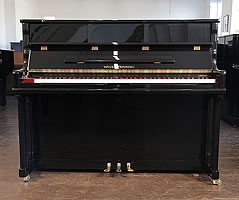 Steinberg Model AT-18 upright piano with a black case and brass fittings