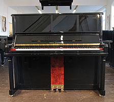 Steinberg Model AT-32 upright piano with a black case, walnut panel and brass fittings