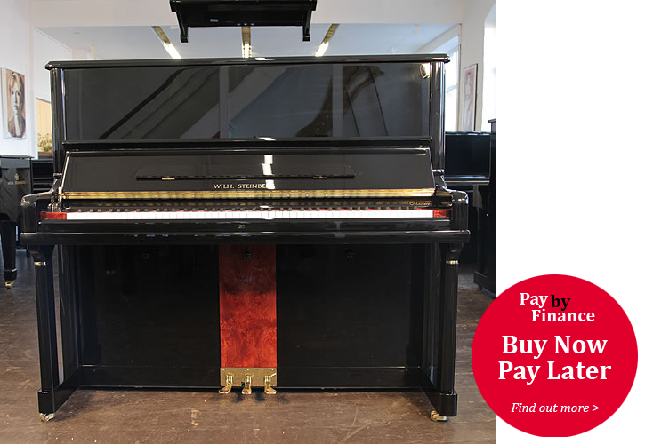 Brand New, Steinberg Model AT-32  upright Piano for sale with a black case.