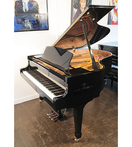 A brand new, Steinberg WS-T166 grand piano with a black case and carbon fibre composite action