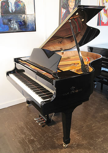 A brand new, Steinberg WS-T166 grand piano with a black case and brass fittings