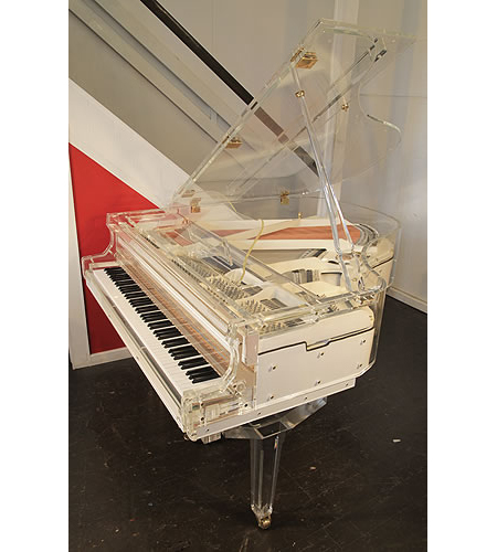 A Steinhoven grand piano with a transparent, acrylic case and fitted PianoDisc iQ airport player system