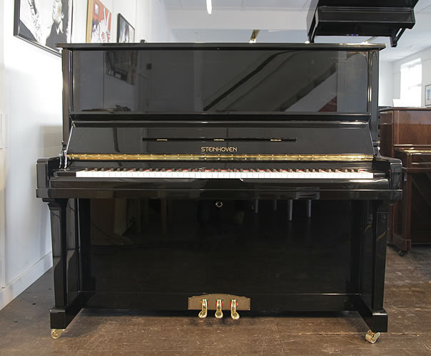 Piano for sale. A brand new Steinhoven HG-133T-R upright piano with a black case and polyester finish