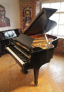 Piano for sale. A 1972, Steinway Model A grand piano with a black case and spade legs. Eighty-eight note keyboard and a three-pedal lyre.