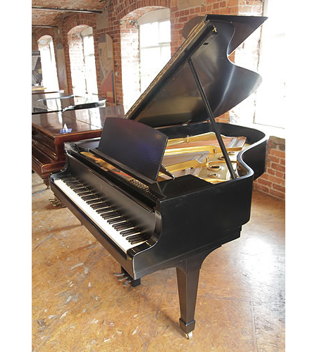 A 1942, Steinway Model A grand piano with a satin, black case and spade legs