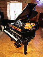 A rebuilt, 1887, Steinway Model A Grand piano for sale with a black case, filigree music desk and fluted, barrel legs.