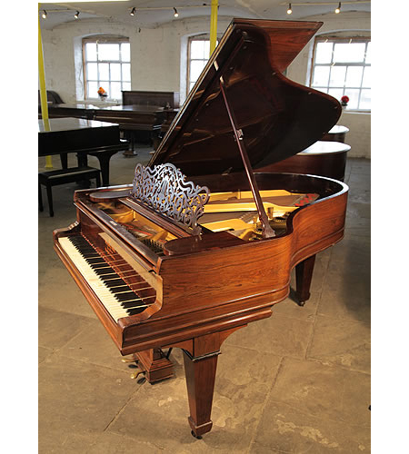 An unrestored, 1901, Steinway Model A grand piano with a rosewood case, filigree music desk and spade legs