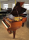An antique, 1901 Steinway Model A grand piano with a rosewood case, filigree music desk and spade legs.