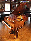 A 1907,  Steinway Model B grand piano with a rosewood case, filigree music desk and spade legs.