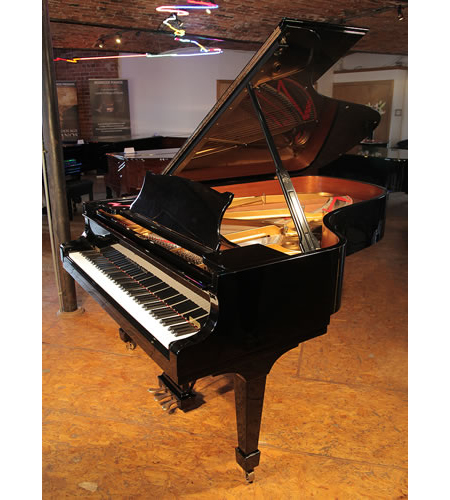 A 2004,  Steinway Model B grand piano with a black case and spade legs