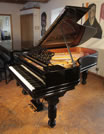Piano for sale. An 1886, Steinway Model B grand piano with a black case, filigree music desk and fluted, barrel legs