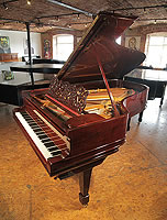 An 1889, Steinway Model B grand piano with a rosewood case, filigree music desk and spade legs.