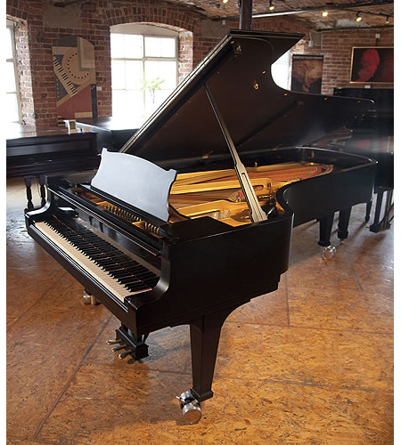 A Steinway Model D concert grand piano with a satin, black case