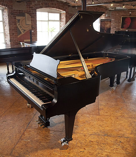 A 1952, Steinway Model D concert grand piano with a satin, black case.