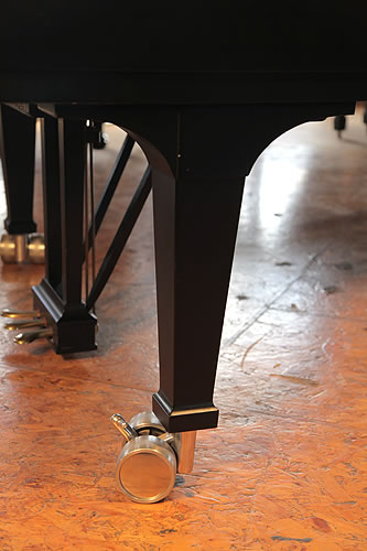 Steinway Model D piano leg with dual casters