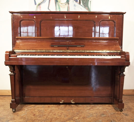 Steinway Model K upright Piano for sale with an walnut case.