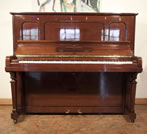 Piano for sale. A 1925, Steinway Model K vertegrand upright piano with a walnut case. Piano has an eighty-eight note keyboard and two pedals