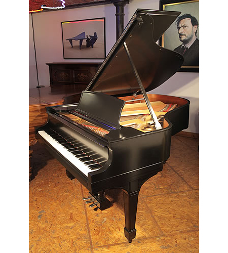 A 1926, Steinway Model L grand piano with a satin, black case and spade legs