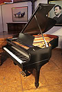 A 1926, Steinway Model L grand piano with a satin, black case and chrome fittings.