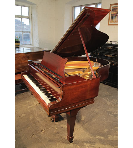 A secondhand, 1927,  Steinway Model M grand piano with a mahogany case and spade legs
