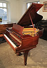 Piano for sale. A 1927, Steinway Model M grand piano with a mahogany case and spade legs.