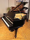 A restored, 1914, Steinway Model O grand piano with a black case and spade legs