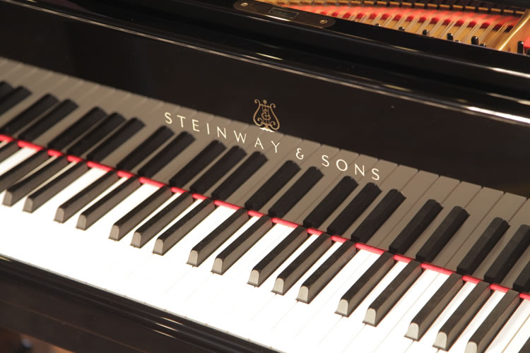 Steinway Model O manufacturers logo on fall
