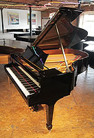 A 1929, Steinway Model O grand piano with a black case and spade legs
