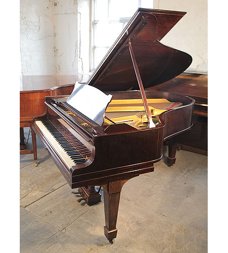 A 1923, Steinway Model O grand piano with a fiddleback mahogany case and spade legs