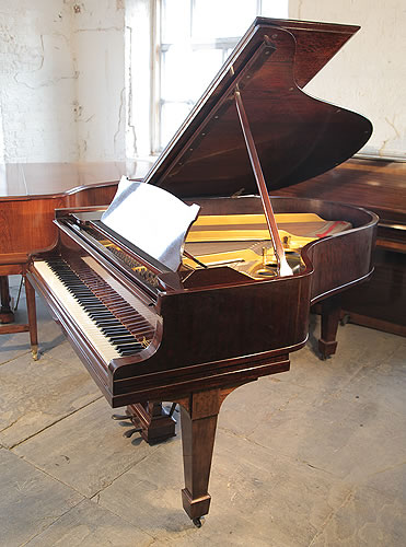 An unrestored, 1923, Steinway Model O grand piano with a fiddleback mahogany case and spade legs