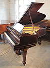 Piano for sale. A  Steinway Model O grand piano with a rosewood case
