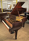 An unrestored, 1901, Steinway Model O grand piano with a rosewood case and spade legs.