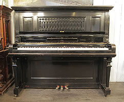 A rare 1918, Steinway Model R upright grand piano with a black case and cut-out front panel.