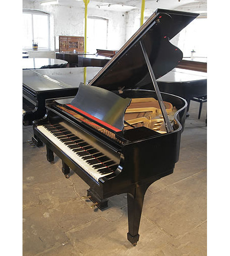 A 1951, Steinway Model S grand piano with a black case and spade legs.