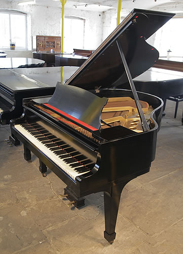 A 1951, Steinway Model S baby grand piano with a black case