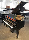 Piano for sale. A  Steinway Model S baby grand piano with a blakc case