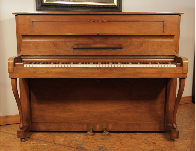 A 1952, Steinway Model Z upright piano with a mirrored, walnut case and cabriole legs