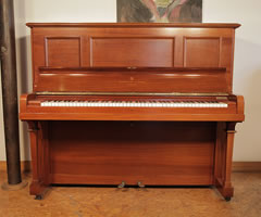 A 1913, Steinway vertegrand piano with a polished, mahogany case