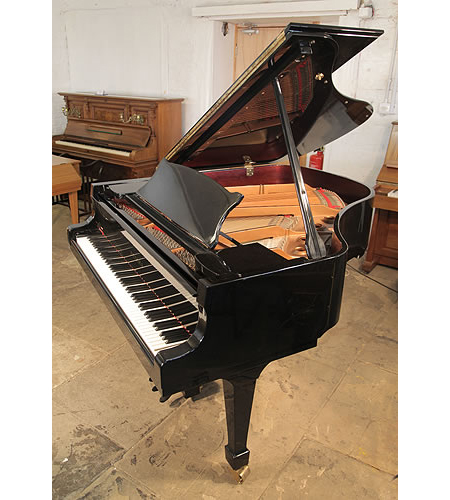 A Toyama TC-162 grand piano for sale with a black case and polyester finish