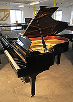 A 1986, Yamaha C5 Grand Piano For Sale with a Black Case and Spade Legs