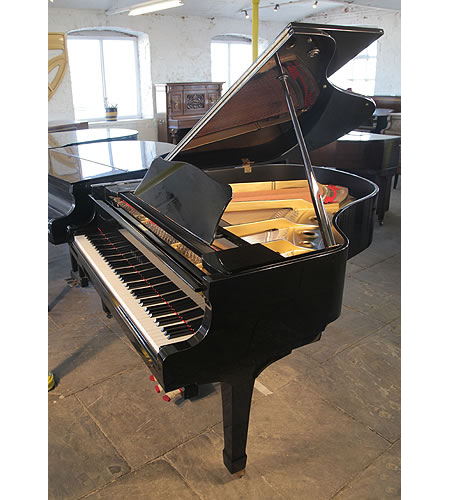 A  1981, Yamaha G2 grand piano for sale with a black case and polyester finish. Piano has eighty-eight notes and a three-pedal lyre