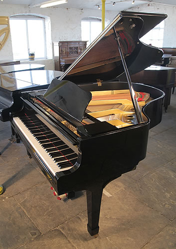 A 1981, Yamaha G2 grand piano for sale with a black case and spade legs