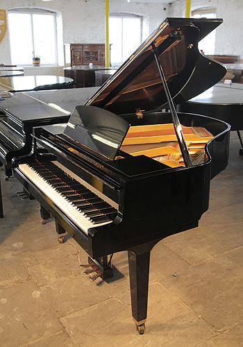 A 1986, Yamaha GH1 grand piano for sale with a black case and polyester finish Piano hass eighty-eight notes and three pedals